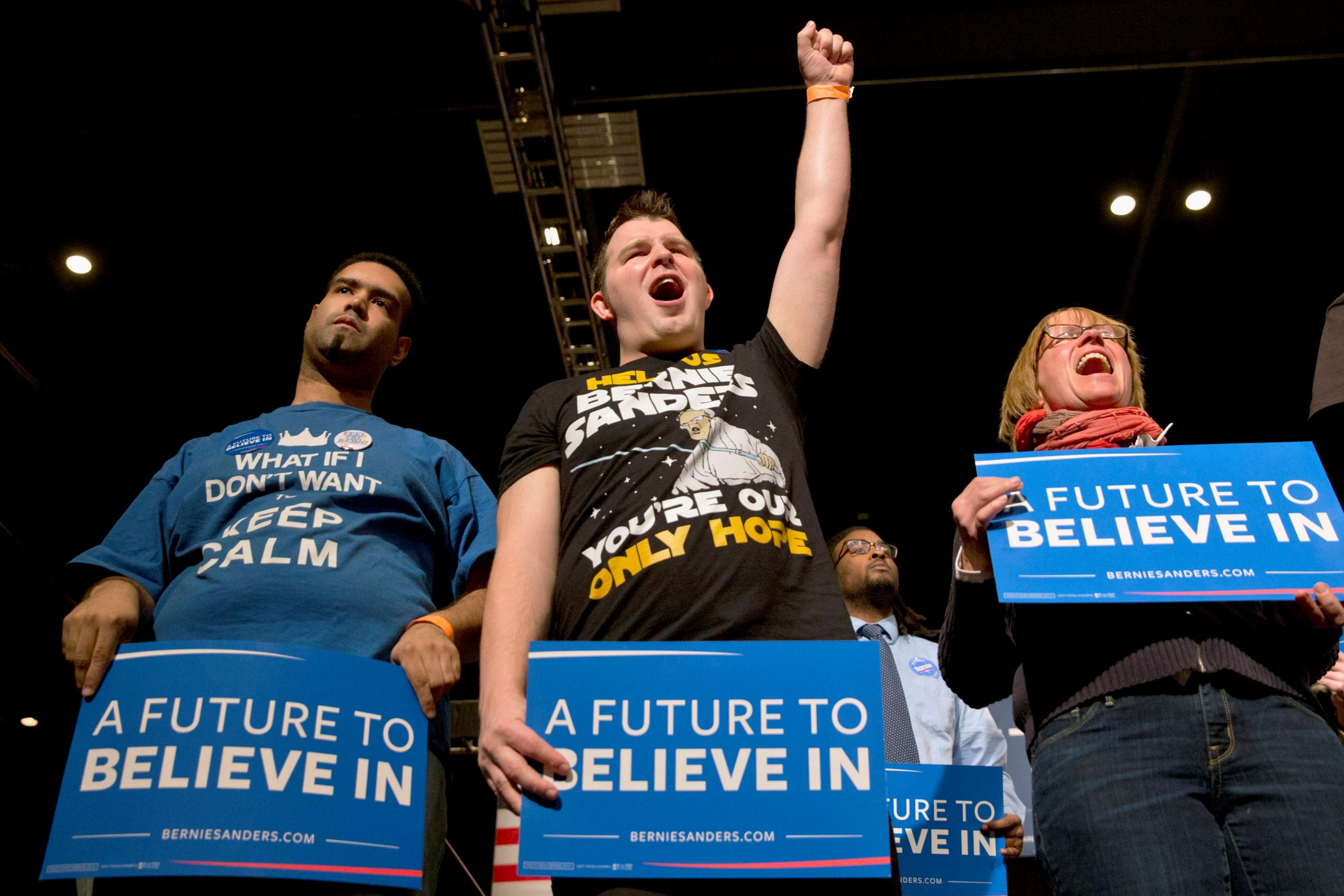 Members of the audience cheer for Democratic presidential candidate, Sen. Bernie Sanders, I-Vt. as he speaks during a campaign rally in Minneapolis, Minn. on  Feb. 29, the day before Super Tuesday.