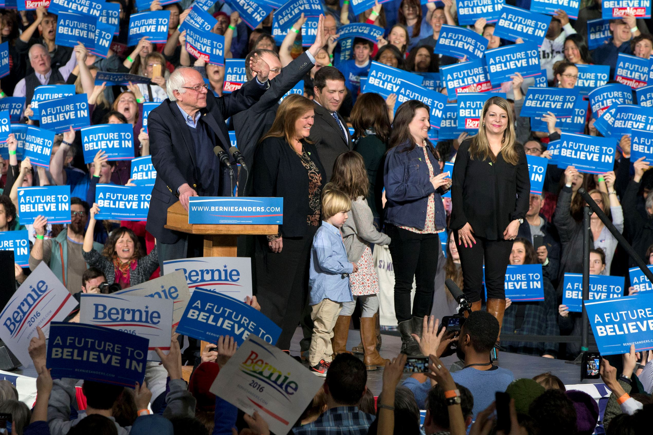 Democratic presidential candidate Sen. Bernie Sanders, I-Vt., waves next to his son Levi Sanders, his wife Jane Sanders, and members of their family during a primary night rally in Essex Junction, Vt., Tuesday, March 1, 2016, on Super Tuesday.