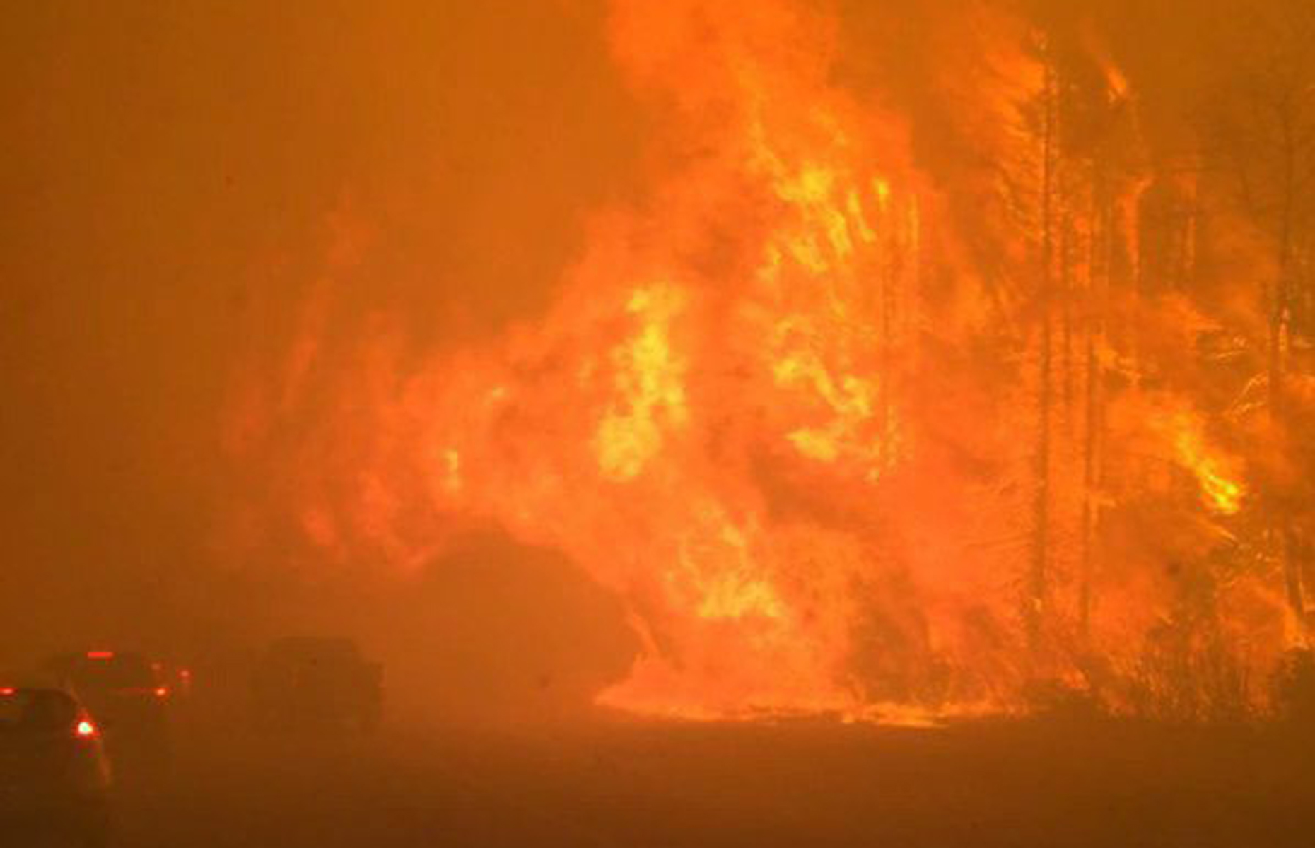 Fire burns near a road in Fort McMurray, Alberta on Tuesday May 3, 2016.