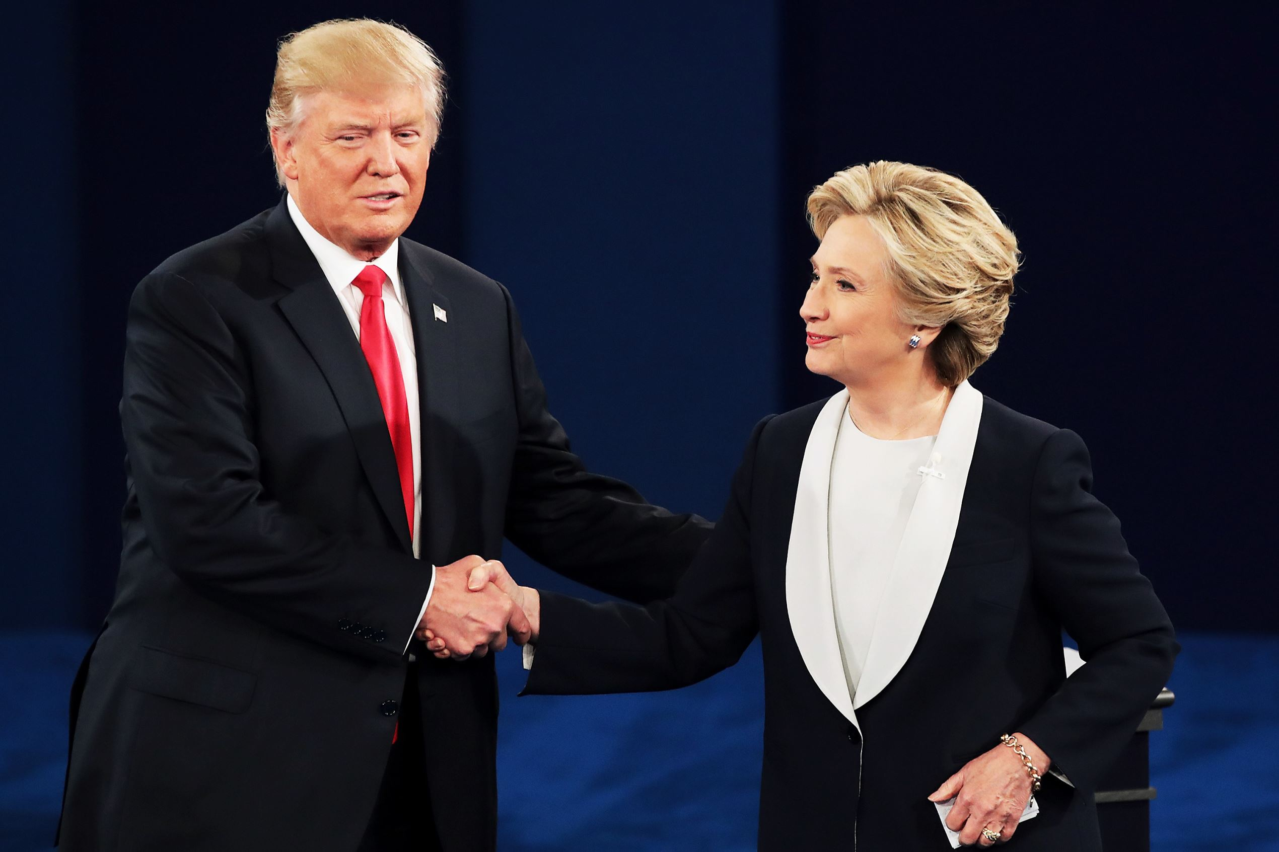 Republican presidential nominee Donald Trump shakes hands with Democratic presidential nominee former Secretary of State Hillary Clinton during the town hall debate at Washington University on Oct. 9, in St Louis, Missouri. This is the second of three presidential debates scheduled prior to the Nov. 8th election.