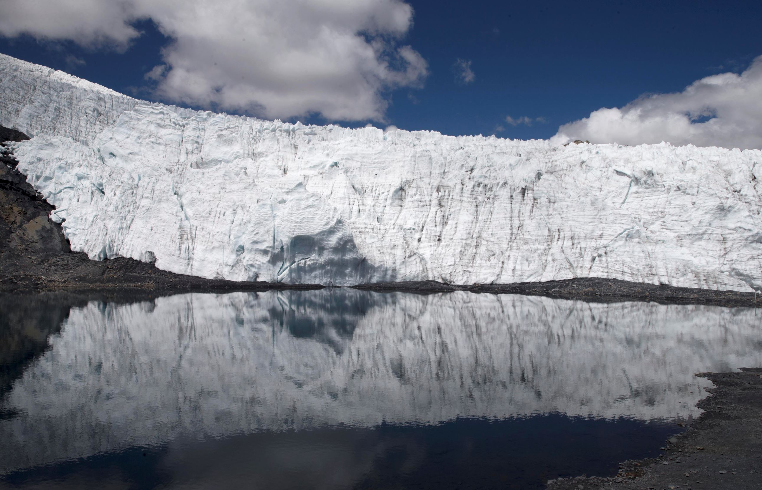 Слайд 70 из 86: In this Aug. 12, 2016 photo, the Pastoruri glacier is reflected in a lagoon in the Huascaran National Park in Huaraz, Peru. Glacial lakes are often pretty fragile structures, created when rocks and rubble carried by a glacier form a moraine that dams up