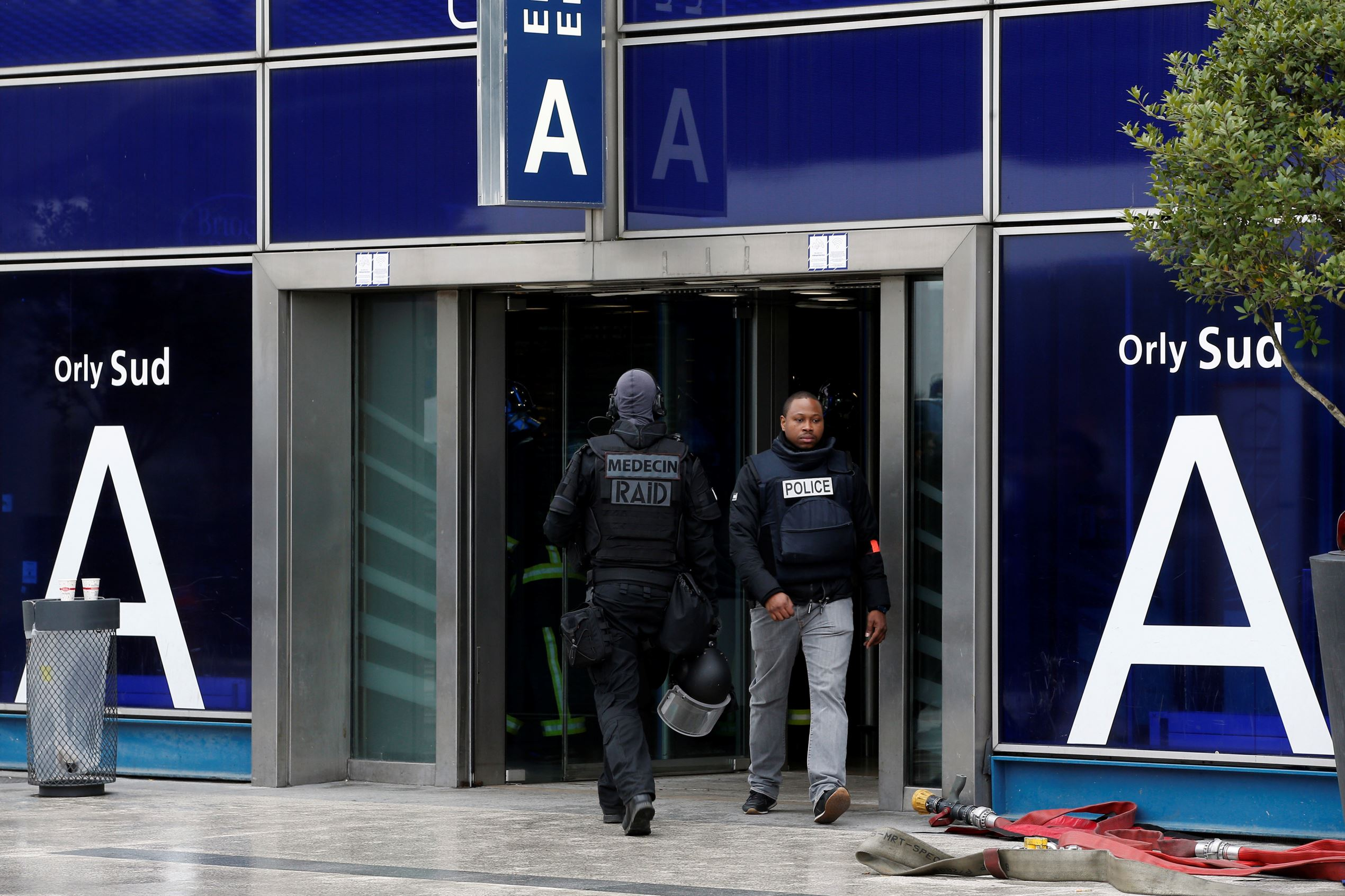 Slide 3 of 14: French elite police forces patrol at the Orly airport departure terminal, south of Paris, Saturday, March, 18, 2017. A man was shot dead Saturday after wrestling a soldier to the ground at Paris' Orly Airport and trying to take her rifle, officials said. No one else in the busy terminal was hurt, but thousands of travelers were evacuated and flights were diverted to the city's other airport.