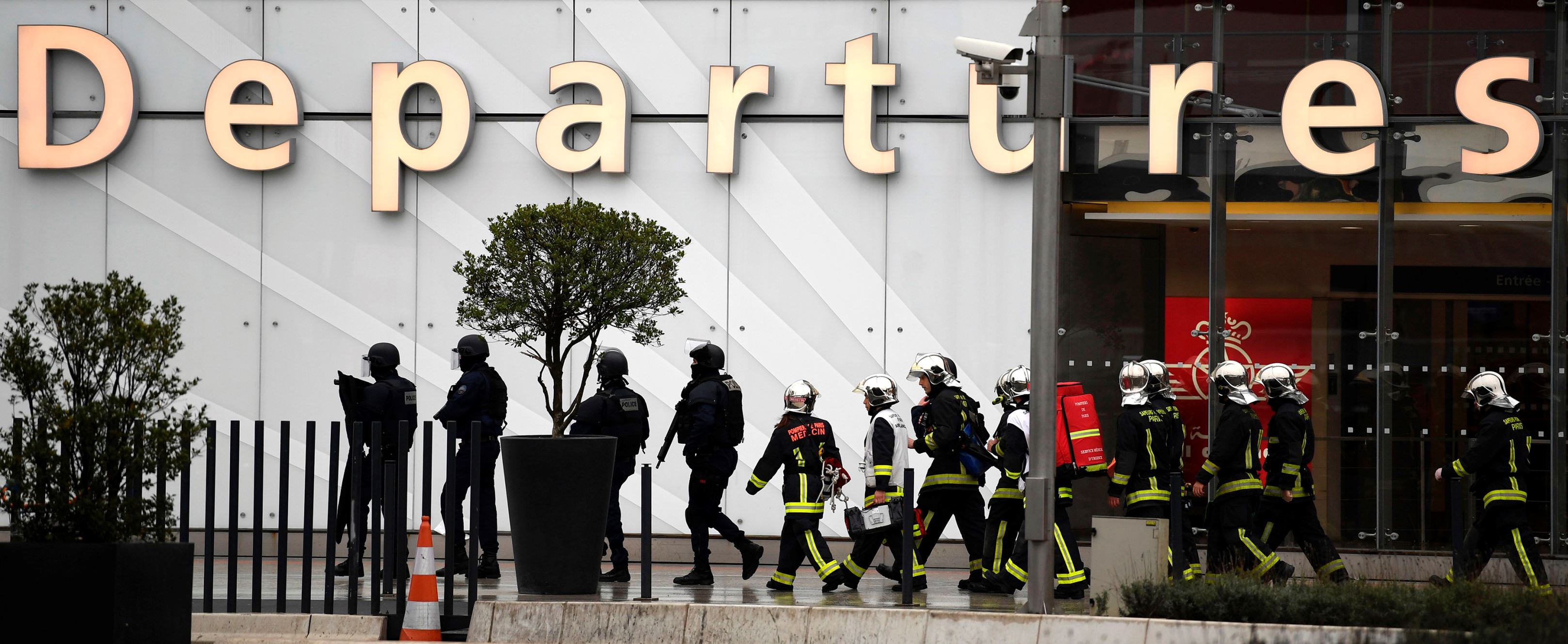 Slide 2 of 14: French firefighters and RAID police unit officers secure Paris' Orly airport on March 18, 2017 following the shooting of a man by French security forces. Security forces at Paris' Orly airport shot dead a man who took a weapon from a soldier, the interior ministry said. Witnesses said the airport was evacuated following the shooting at around 8:30am (0730GMT). The man fled into a shop at the airport before he was shot dead, an interior ministry spokesman told AFP. He said there were no people were wounded in the incident.