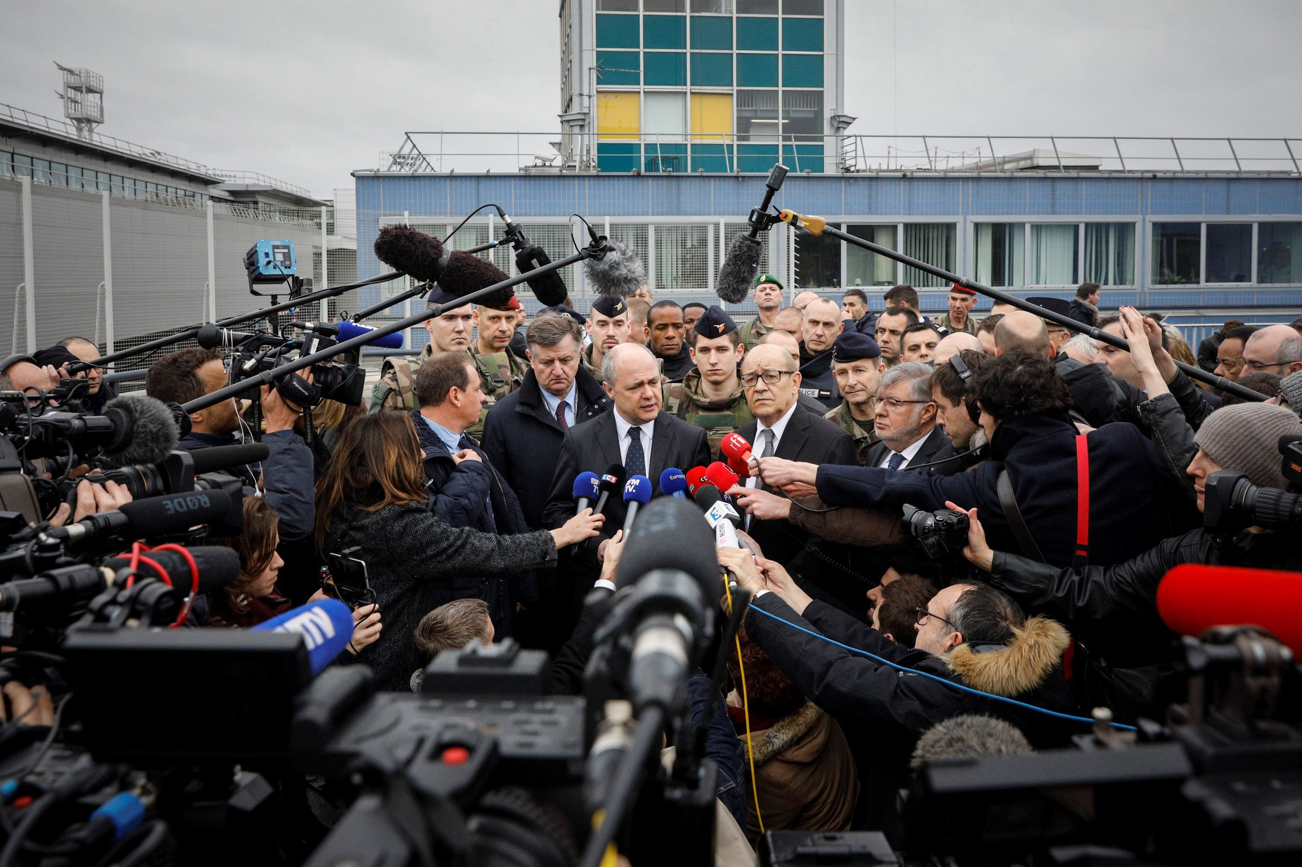 Slide 9 of 14: French Interior Minister Bruno le Roux, center left, and French Defense Minister Jean-Yves le Drian, center right, answer reporters at Orly airport, south of Paris, Saturday, March, 18, 2017. A man was shot to death Saturday after trying to seize the weapon of a soldier guarding Paris' Orly Airport, prompting a partial evacuation of the terminal, police said.