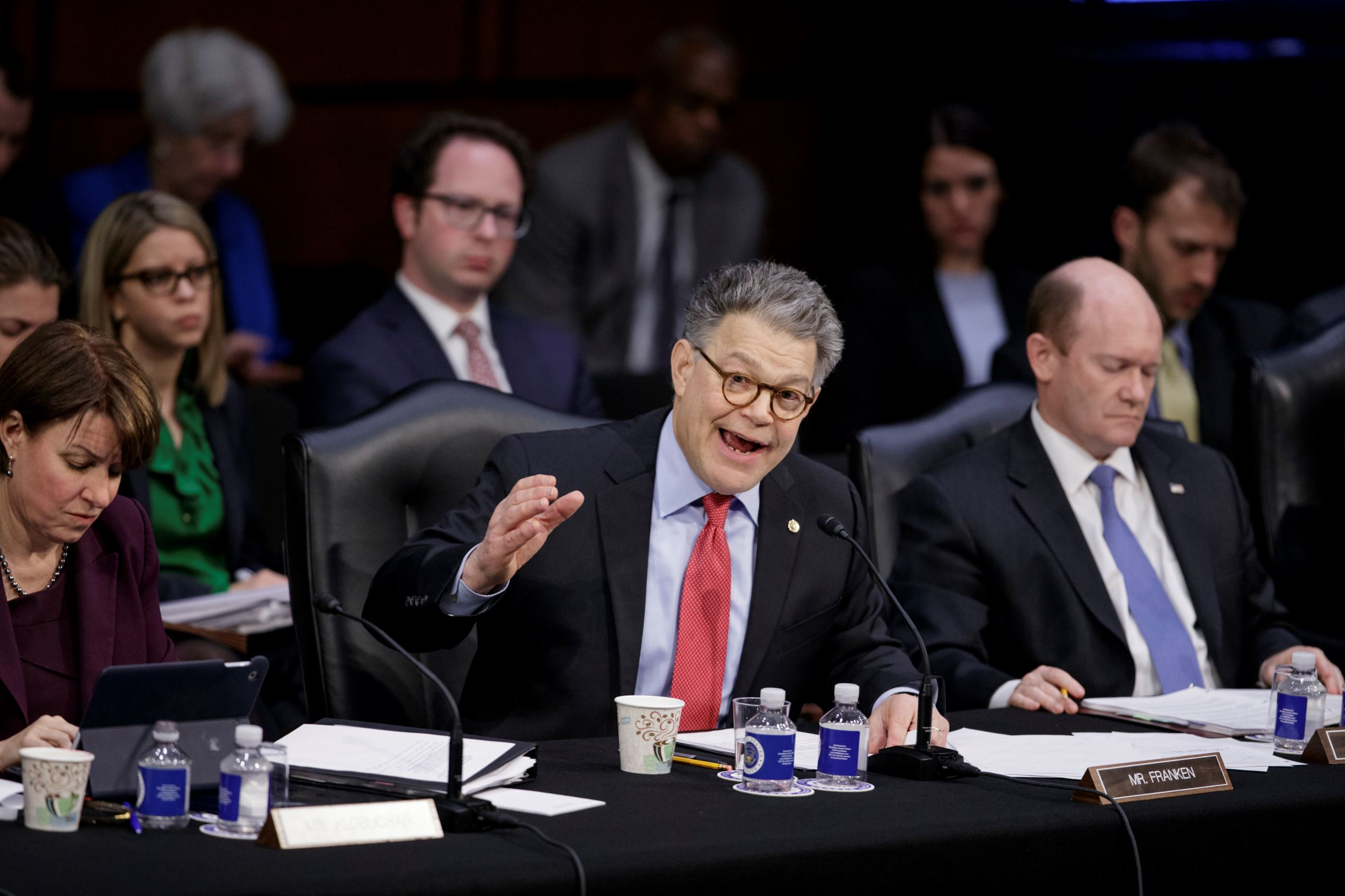 Sen. Al Franken, D-Minn., center, flanked by other Democratic members of the Senate Judiciary Committee, Sen. Amy Klobuchar, D-Minn., left, and Sen. Chris Coons, D-Del., question the Republican side as the panel meets to advance the nomination of President Donald Trump's Supreme Court nominee Neil Gorsuch, Monday, April 3, 2017, on Capitol Hill in Washington.