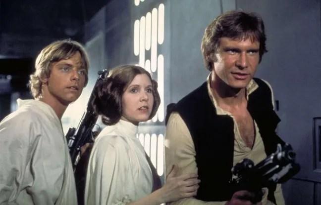 De gauche à droite: Mark Hamill (dans le rôle de Luke Skywalker), Carrie Fisher (Princesse Leia) et Harrison Ford (Han Solo), dans «Star Wars: Episode IV».