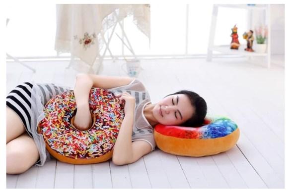 Housewife lying on donut cushions