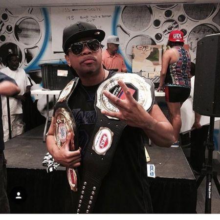 Omar holding belts
