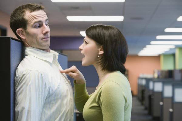 Businesswoman yelling at businessman