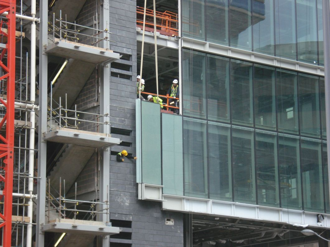 Spandrel glass curtain wall functionalities