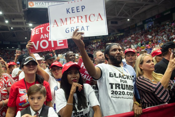 Donald Trump supporters at US President's meeting on Wednesday, October 31 in Estero, Florida / AFP / Archives