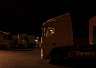 A truck driver drives his truck in the parking lot of Escale near Châteauro ...