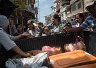 Sister Sofia distributes food to Venezuelan migrants in the streets of Tumb ...