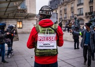 """A photographer journalist carries a sign """"Gentil photographer"""" at the time of ..."""