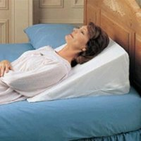 How to Use a Bed Wedge for Sleeping | LIVESTRONG.COM