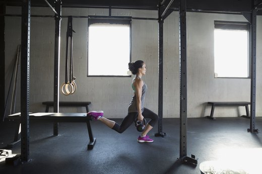2. Replace Leg Extension Machine With Kettlebell Split Squats