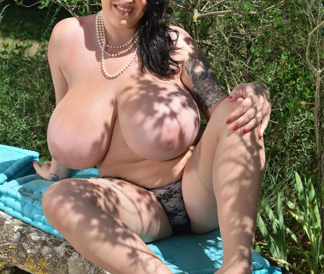 Leanne Crow Shows Off Big Tits In Nude Stockings Outdoors Main Image