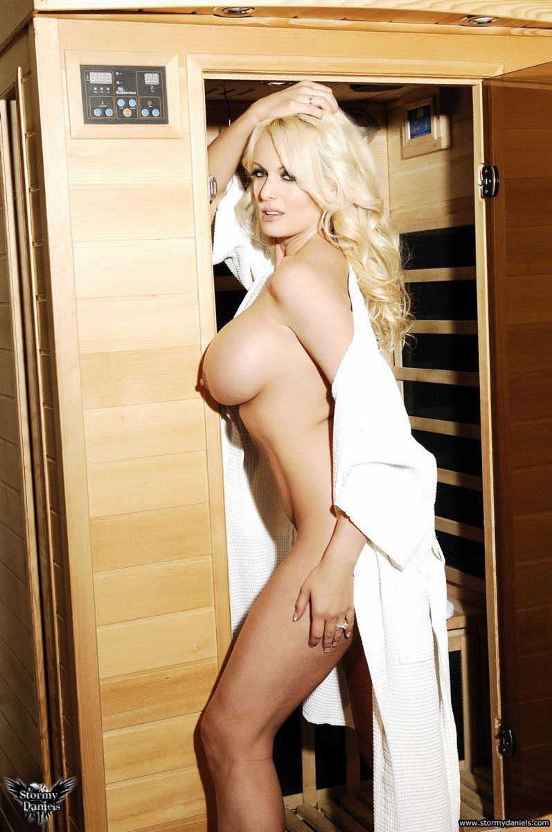 Stormy Daniels strips off her white robe in a hot sauna