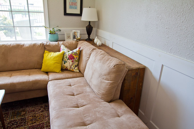Pushing furniture up against the wall makes everything look and feel cramped. Even just few inches in between the wall and your bigger items can make the space look more open. To make use of those few inches, you can DIY a console table to slip behind it. Get the directions here.