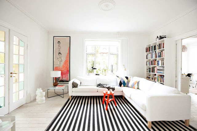 decorating ideas to make a small living room look bigger pictures of modern interior design 19 foolproof ways space feel so much just like vertical stripes on clothing striped rug will your appear longer