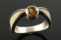 """This """"Harry Potter"""" Golden Snitch Engagement Ring Is Perfect"""