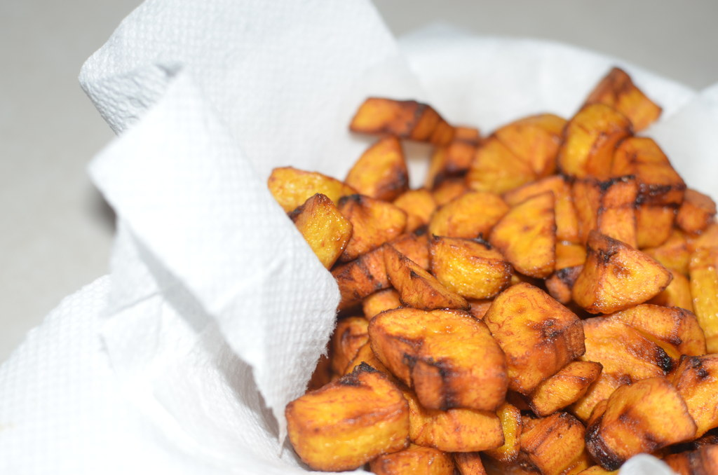"What it is: Pronounced ""doh-doh"", these are deep fried plantains (not bananas), cut in slim diagonal slices, circles or cubes (colloquially known as ""party dodo"") and deep-dried. Some people like to sprinkle some salt on before frying, but that's down to personal taste. It's a snack, a side dish, a main meal, a blessing.Why it's awesome: It tastes like a mother's love. It's impossible to cook it badly. It's both a whole meal and a side dish. It is the best thing.You don't really need a recipe for this: just peel, chop and fry. Crack open a Supermalt and eat it on the veranda."
