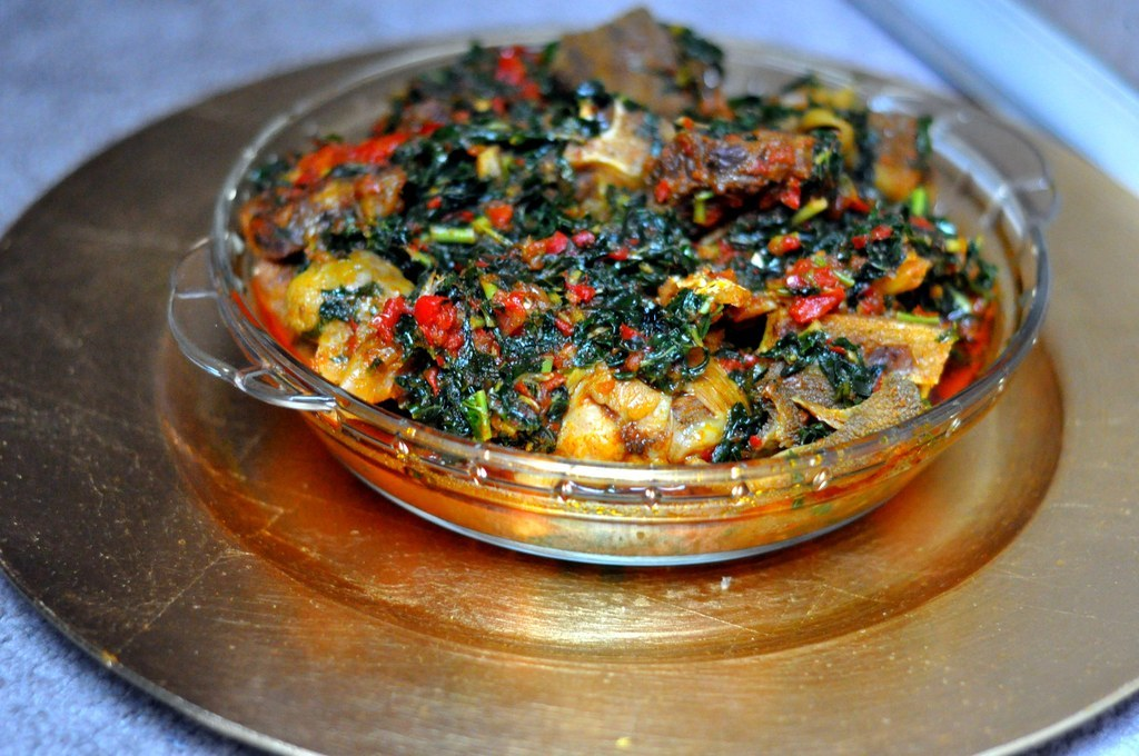 "What it is: A literal translation from the Yoruba is ""mixed greens"" and while they are the star of this rich, fragrant vegetable stew, there's so much goodness besides: blended scotch bonnets, bell pepper, onions and locust beans. This is a classic Yoruba dish.Why it's awesome: It goes with everything. Purists insist authentic efo riro must have efinrin (African spinach) and efo soko (Lagos spinach). Others say tomatoes are banned (to prevent sogginess). Some insist on palm oil over vegetable oil. All agree it's freakin' delicious.You can find recipes here, one with tomatoes here, and a variation that uses kale here.If you're interested in some of the scores of green leafy vegetables used in a lot of Nigerian cooking, here's a handy list."