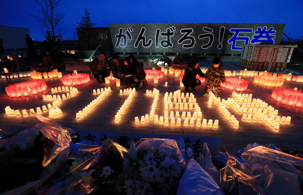 "Residents of the city of Ishinomaki, in Japan's Miyagi prefecture, lit candles to form ""3.11 memorial."" The area was one of the hardest hit by the tsunami."