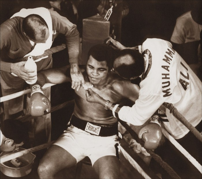 """The most famous boxing corner in history, Wali """"Blood"""" Muhammad and Drew """"Bundini"""" Brown, at work on the Champ late in his first fight against Spinks in 1978. The 24-year-old Spinks had fought only seven fights in his career when he beat Ali."""