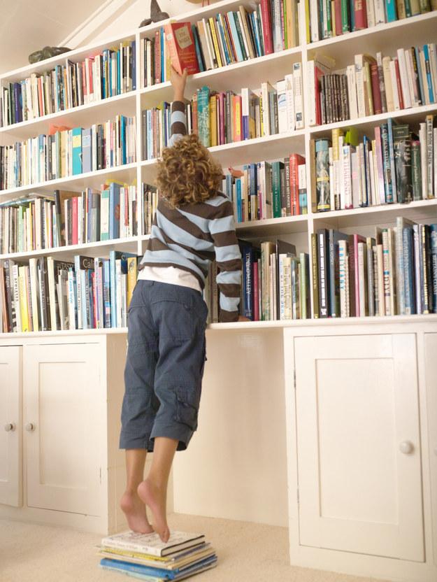 Grabbing something from a high shelf.