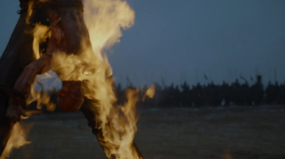 Next we see a flayed man (this is what Boltons do to their enemies) on a battlefield. Who it is is anyone's guess, but it's probably not Stannis.
