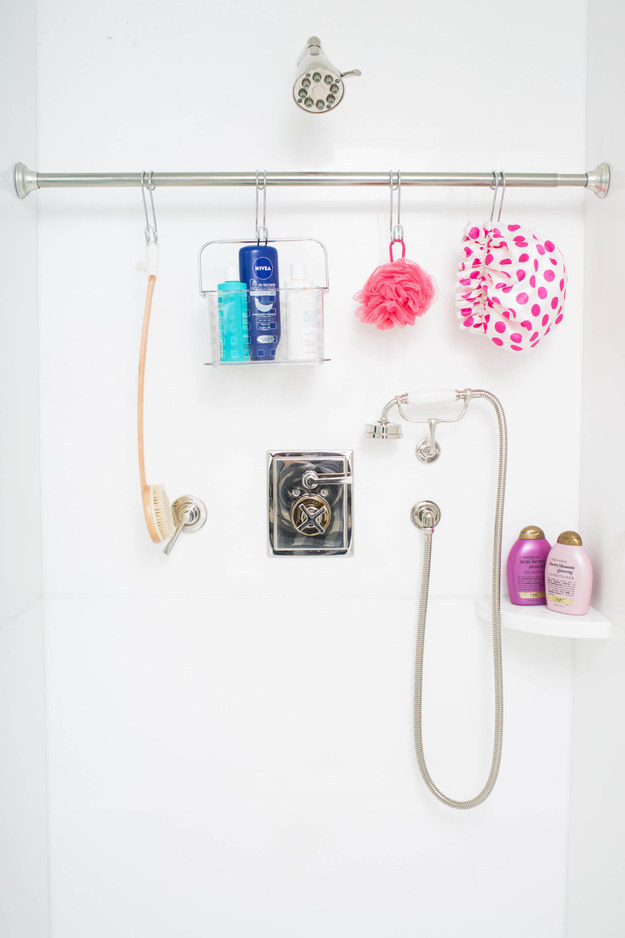 Or hang an extra tension rod in your shower and use s-hooks for organizing.
