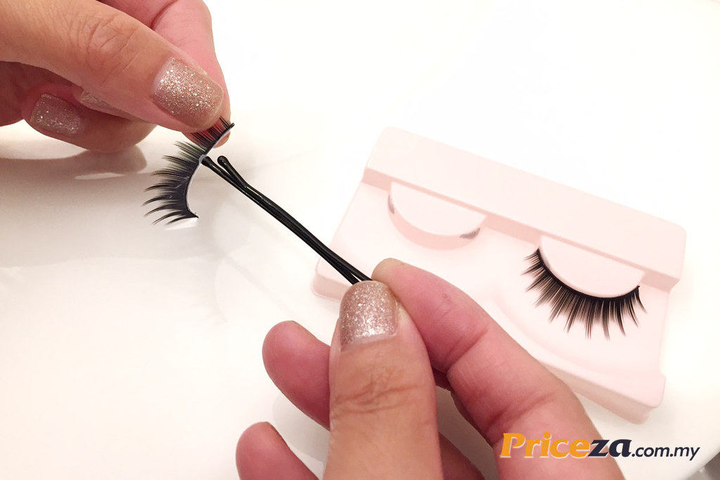 To avoid putting on too much lash glue squeeze some glue onto the back of your hand or onto a table and use a bobby pin to spread it evenly along the base of the strip.