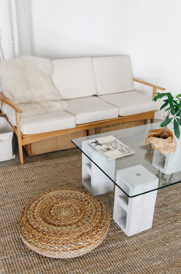 Make a simple coffee table with cinder blocks and a glass top.