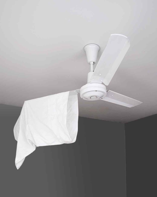 Use an empty (old) pillowcase to dust off your fan's blades.