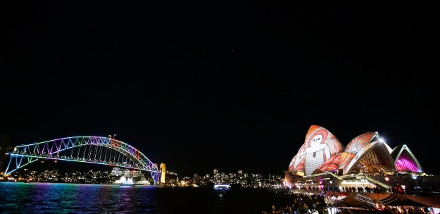 Landmarks like the Opera House and Harbour Bridge are illuminated with vibrant, mind-melting colors and designs.