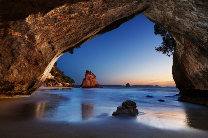 Travel to the other side of the globe for the sights at Cathedral Cove Beach in New Zealand.