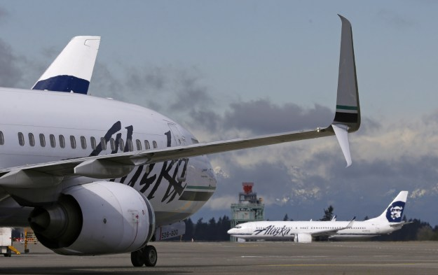 An Alaska-bound flight was diverted to Seattle on Tuesday after a man was accused of attempting to kiss a sleeping teen girl, an airport spokesperson told BuzzFeed News.