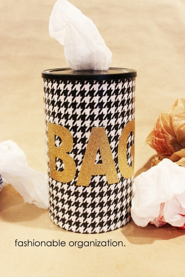 Turn an empty coffee can or food container into a stylish bag dispenser.