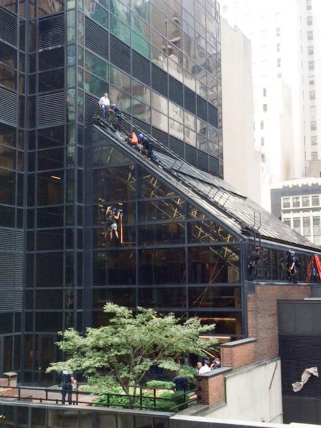 A man using suction cups scaled Trump Tower in midtown Manhattan on Wednesday, prompting a large police response.