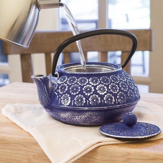 A lovely floral teapot with a stainless steel tea infuser.