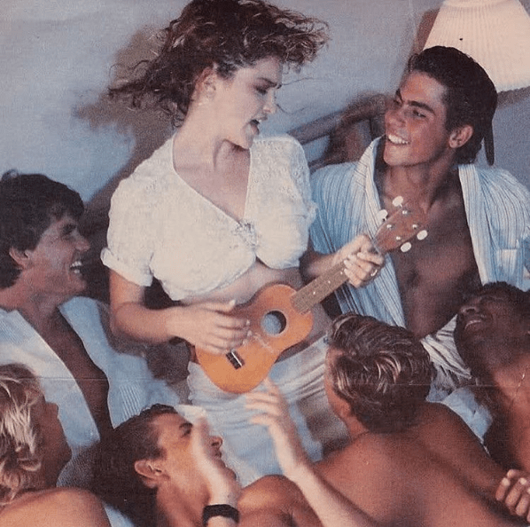 Madonna posted this '80s pic of herself playing the ukulele to a bunch of guys ¯_(ツ)_/¯.