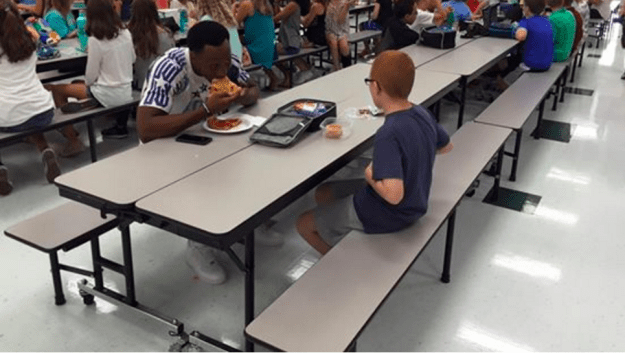 "So when a friend sent Paske the photo saying, ""Travis Rudolph is eating lunch with your son,"" Paske, who only then learned that Rudolph was an FSU football player, said, ""I had tears streaming down my face."""