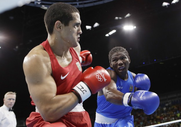 Cameroon's Hassan N'Dam and Brazil's Michel Borges battle it out in a light heavyweight match.