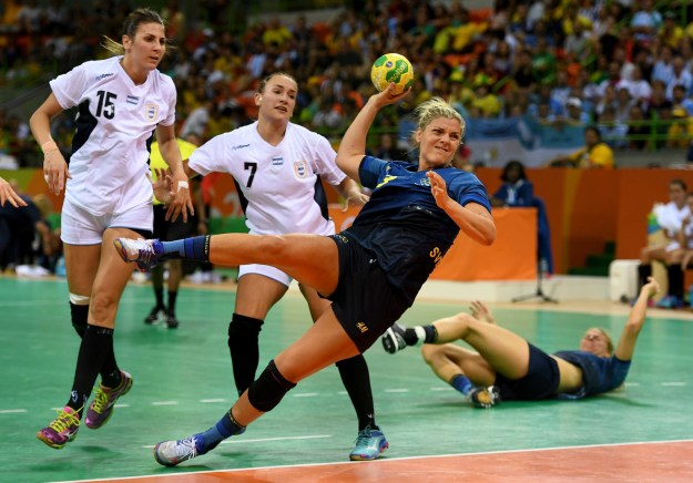 Frida Tegstedt of Sweden determined to make a shot against Argentina in the women's handball match.