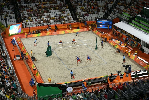 Beach volleyball is played by teams of two in a 16 by 8 meter court.
