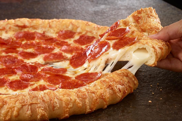According to Time.com, each 12-inch pizza only costs $9 which is ABSURDLY REASONABLE because LOOK AT THAT CHEESE BRIDGE.