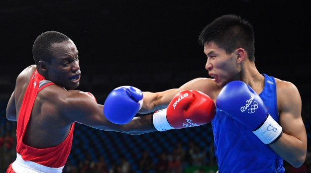 Kenya's Peter Mungai Warui went up against China's Lu Bin in a Men's Light Fly (46-49 kilogram) boxing match at the Rio Olympics on Monday.