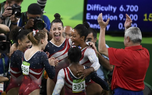 Team USA won gold Tuesday in the women's gymnastics team final, beating Russia and China by the largest margin ever since the scoring system was overhauled in 2006.
