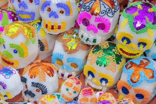 Those lovely sugar skulls are representative of the souls of the departed.